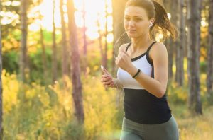 woman running while listening to audio books